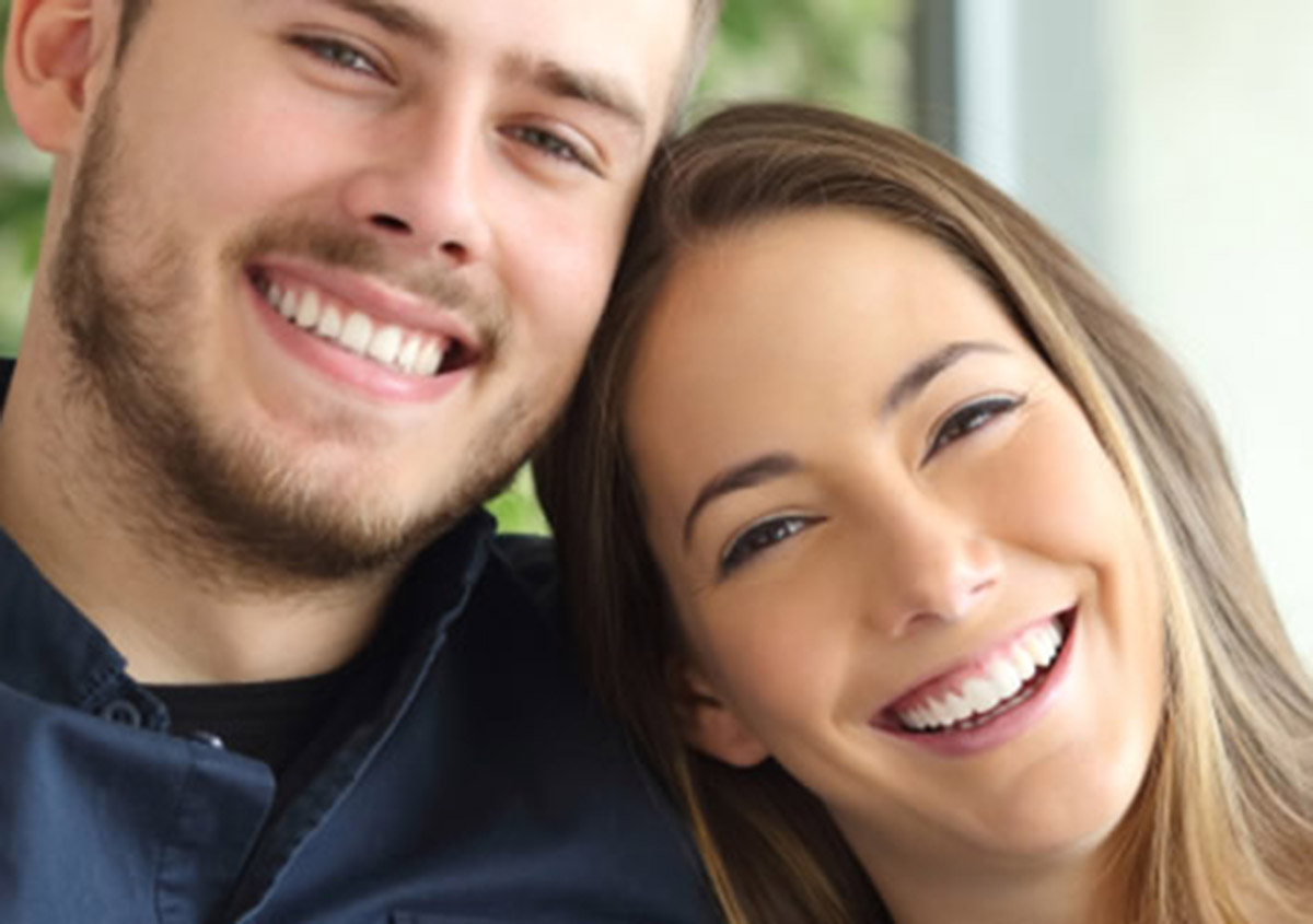 Happy couple who has recieved benefits from cosmetic dentist in Garland TX