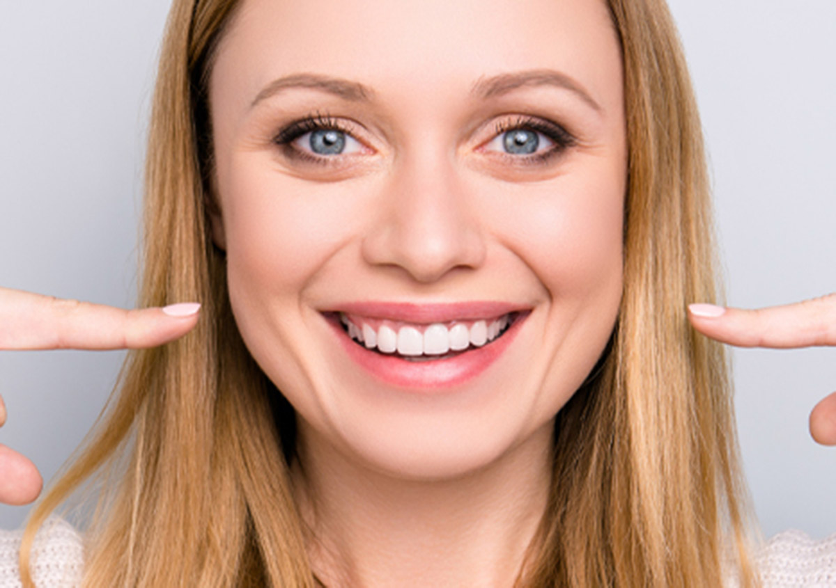 Veneers can address short teeth and other imperfections